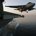 An S-3b Viking Clears The Flight Deck by Stocktrek Images