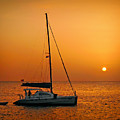 Anchored Sailboat At Sunset by Carolyn Derstine
