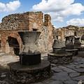 Ancient Pompeii - Bakery Of Modestus Millstones And Bread Oven by Georgia Mizuleva