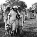 Angel On The Ground At Calvary Cemetery In Nyc New York by David Wolanski