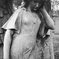 Angel On The Ground At Cavalry Cemetery, Nyc, Ny by David Wolanski