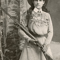 Annie Oakley With A Rifle, 1899 by Richard Kyle Fox