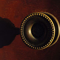 Antique Cabinet Handle And Shadow by Steve Somerville