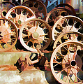 Antique Wagon Wheels And Baskets by Jennifer Stackpole