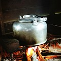 Antique Water Kettle On A Fire In Malaysia by Gosta Eger