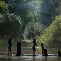 Asian Girl Playing Water In River by Somchai Sanvongchaiya