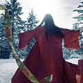 Asian Woman In Red Kimono Dancing In The Snow Spinning Around To by Awen Fine Art Prints