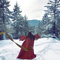 Asian Woman In Red Kimono Dancing On The Snow In The Forest by Awen Fine Art Prints
