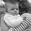 Baby Content On Mom's Shoulder by Cary Leppert