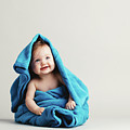 Baby Girl Covered With A Blue Warm Blanket by Michal Bednarek