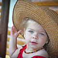 Baby Girl Wearing Straw Hat by Zoltan Albertini
