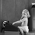 Baby Girl With Adding Machine, C.1940s by H. Armstrong Roberts/ClassicStock