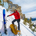Backcountry Skier Preps For Ice Climbing On Cobb Peak In Idaho by Elijah Weber