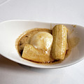 Bananas Foster In A White Dish by Louise Heusinkveld