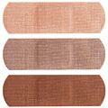Bandages In Different Skin Colors by Blink Images