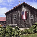 Barn And American Flag by Sally Weigand