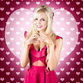 Beautiful Blonde Woman Gesturing Heart Shape by Jorgo Photography - Wall Art Gallery