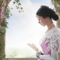 Beautiful Victorian Woman In Pink Dress Standing Under A Wisteri by Lee Avison