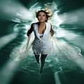 Beautiful Woman Diving In The Water by Oleksiy Maksymenko