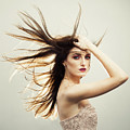 Beautiful Young Woman With Windswept Hair by Amanda Elwell