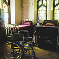 Beds And Wheelchair In Abandoned Church by Dylan Murphy