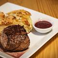 Beef Steak With Potato And Cheese Bake by Jacek Malipan