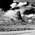 Between Monument Valley And Canyon De Chelley by Paul Basile