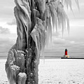 Beyond The Ice Reaper's Grasp -  Menominee North Pier Lighthouse by Mark J Seefeldt