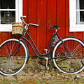 Bicycle In Front Of Red House In Sweden by Greg Matchick