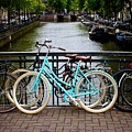 Bicycle Parked At The Bridge In Amsterdam. Netherlands. Europe by Bernard Jaubert