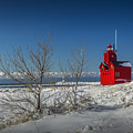 Big Red Lighthouse In Winter by Randall Nyhof