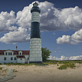 Big Sable Lighthouse Under Cloudy Blue Skies by Randall Nyhof