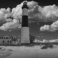 Big Sable Lighthouse Under Cloudy Skies by Randall Nyhof