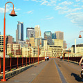 Biking On The Stone Arch Bridge by James Kirkikis