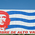 Billboard With The Iconic Che Guevara Portrait And National Cuban Flag by Sami Sarkis