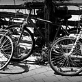 Black And White Leaning Bikes by Emily Kelley