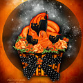 Black Cat Cupcake by Carol Cavalaris