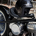 Black Vintage Style Motorcycle With Chrome And Black Helmet by Jason Rosette