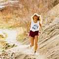 Blond Woman Trail Runner by Steve Krull
