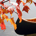 Blue Canoe In Fall by Betsy Derrick