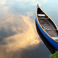 Blue Canoe In The Clouds by Betsy Derrick