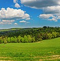 Blue Cloudy Sky Over Green Hills And Country Road by Lukasz Szczepanski