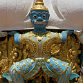 Blue Faced Man On Golden Buddha Statue, Tiger Cave Temple by Aivar Mikko