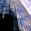 Blue Skyscrapper With A Blue Sky In New Orleans Louisiana by Travel Back And Forth