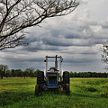 Blue Tractor Green Field by Toni Hopper