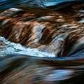 Blurred Cascades On The Autumn River by Jozef Jankola