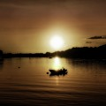 Boat At Sunset Glow - Sepia  by Lilia D
