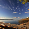 Boat Dock And Autumn Trees Along A Saskatchewan Lake by Mark Duffy