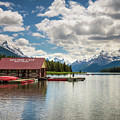 Boat House And Canoes On A Jetty At Maligne Lake In Canada by Miroslav Liska