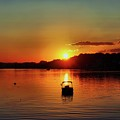 Boat In Sunset Glow by Lilia D